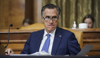 Sen. Mitt Romney, R-Utah, attends a Senate Budget Committee hearing to discuss President Joe Biden's budget request for FY 2022 on Tuesday, June 8, 2021, on Capitol Hill in Washington. (Greg Nash/Pool via AP) ** FILE **