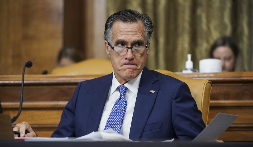 Sen. Mitt Romney, R-Utah, attends a Senate Budget Committee hearing to discuss President Joe Biden's budget request for FY 2022 on Tuesday, June 8, 2021, on Capitol Hill in Washington. (Greg Nash/Pool via AP)