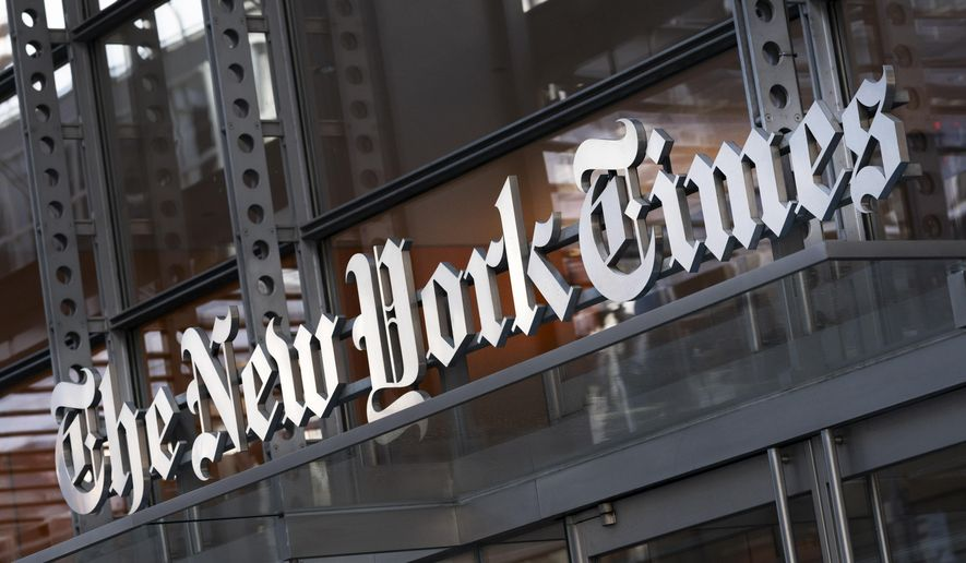 In this Thursday, May 6, 2021, file photo, a sign for The New York Times hangs above the entrance to its building, in New York. Numerous websites were unavailable on Tuesday, June 8, 2021, after an apparent widespread outage at cloud service company Fastly. (AP Photo/Mark Lennihan, File)