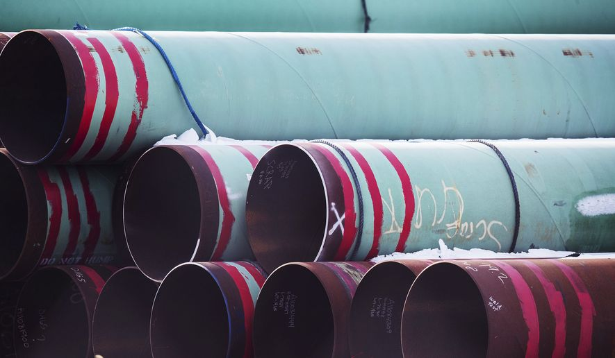 In this Dec. 18, 2020, file photo, pipes to be used for the Keystone XL pipeline are stored in a field near Dorchester, Neb. Calgary-based TC Energy, sponsor of the Keystone XL crude oil pipeline, said Wednesday, June 9, 2021, that it was pulling the plug on the contentious project after Canadian officials failed to convince President Joe Biden to reverse its cancellation of its permit on the day he took office. (Chris Machian/Omaha World-Herald via AP, FIle) ** FILE **