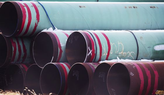 In this Dec. 18, 2020, file photo, pipes to be used for the Keystone XL pipeline are stored in a field near Dorchester, Neb. Calgary-based TC Energy, sponsor of the Keystone XL crude oil pipeline, said Wednesday, June 9, 2021, that it was pulling the plug on the contentious project after Canadian officials failed to convince President Joe Biden to reverse its cancellation of its permit on the day he took office. (Chris Machian/Omaha World-Herald via AP, FIle) **FILE**