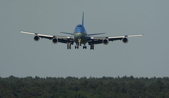 Air Force One, carrying U.S. President Joe Biden and first lady Jill Biden comes into land at RAF Mildenhall, near Bury St Edmunds, in eastern England, Wednesday, June 9, 2021. Biden will attend the G7 summit in Cornwall in southwest England. (AP Photo/Matt Dunham)