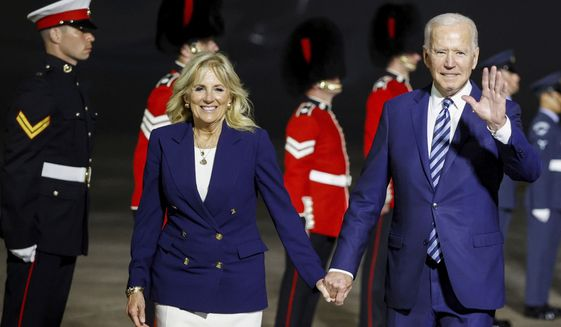 U.S. President Joe Biden and first lady Jill Biden arrive on Air Force One at Cornwall Airport Newquay, near Newquay, England, ahead of the G7 summit in Cornwall, early Thursday, June 10, 2021. (Phil Noble/Pool Photo via AP)