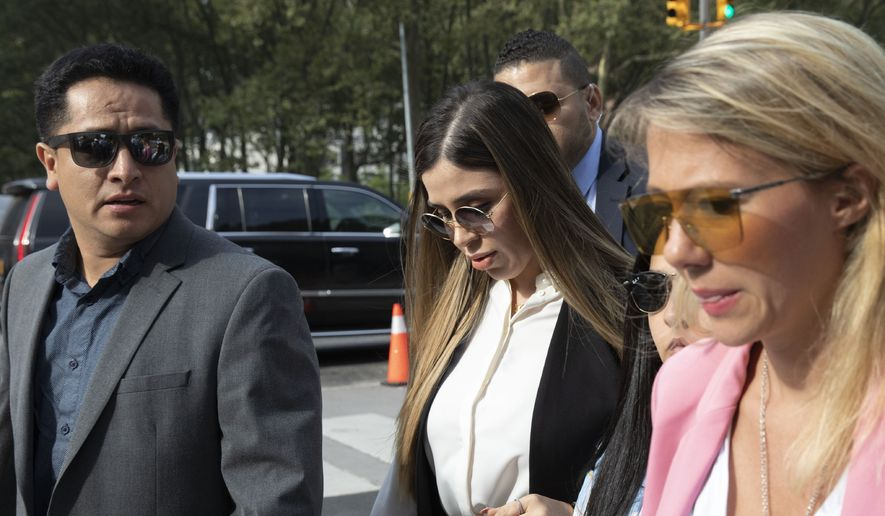 """In this July 17, 2019 file photo, Emma Coronel Aispuro, center, wife of Mexican drug lord Joaquin """"El Chapo"""" Guzman, arrives for his sentencing at Brooklyn federal court, in New York. Emma Coronel Aispuro is expected to plead guilty to federal criminal charges after she had been charged in the U.S. with helping her husband run his multibillion-dollar criminal empire. She is due in court Thursday, June 10, 2021, in Washington for a plea agreement hearing, according to court records. (AP Photo/Mark Lennihan, File)  **FILE**"""