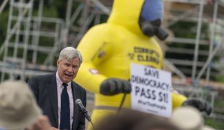 Sen. Sheldon Whitehouse, D-R.I., speaks at a rally in front of the Supreme Court in Washington, Wednesday, June 9, 2021, to support the Senate's upcoming election bill. (AP Photo/Andrew Harnik)