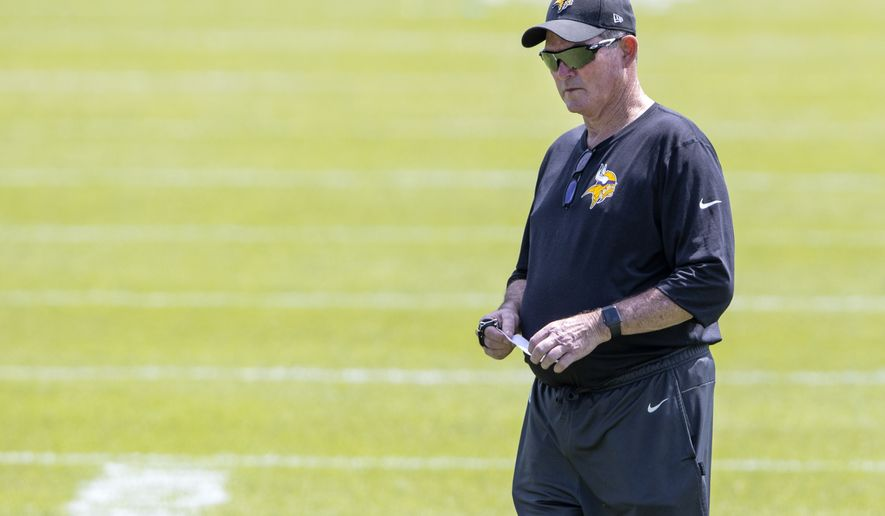 Minnesota Vikings head coach Mike Zimmer watches practice Wednesday, June 9, 2021, in Eagan, Minn. (Carlos Gonzalez/Star Tribune via AP)