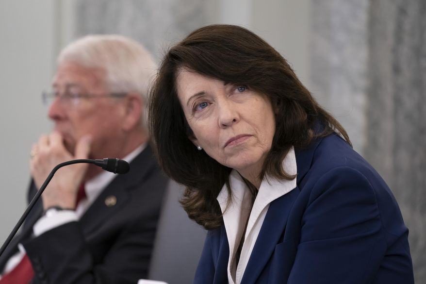 Sen. Maria Cantwell, D-Wash., chair of the Senate Commerce, Science, and Transportation Committee, joined at left by Sen. Roger Wicker, R-Miss., holds a hearing on student-athlete compensation and federal legislative proposals to enable athletes participating in collegiate sports to monetize their name, image, and likeness, at the Capitol in Washington, Wednesday, June 9, 2021. (AP Photo/J. Scott Applewhite) **FILE**