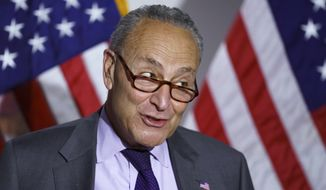 Senate Majority Leader Chuck Schumer, D-N.Y., speaks to reporters after the Democrats' policy luncheon, on Capitol Hill in Washington, Tuesday, May 11, 2021. (AP Photo/J. Scott Applewhite)