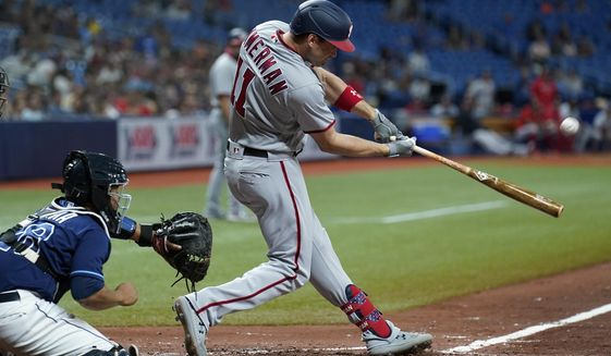Washington Nationals' Ryan Zimmerman (11) connects for a two-run home run off Tampa Bay Rays relief pitcher Jeffrey Springs during the fifth inning of a baseball game Wednesday, June 9, 2021, in St. Petersburg, Fla. (AP Photo/Chris O'Meara)