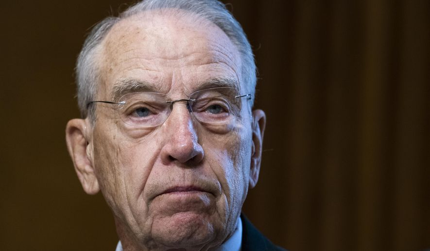 In this Tuesday, June 8, 2021, photo, Sen. Chuck Grassley, R-Iowa, listens during a Senate Finance Committee hearing on the IRS budget request on Capitol Hill in Washington. (Tom Williams/Pool via AP) **FILE**