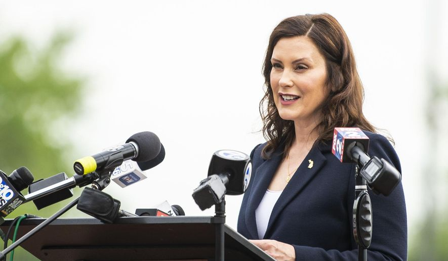 Michigan Gov. Gretchen Whitmer speaks during a press event providing an update on the state's COVID-19 response at Dow Diamond on Thursday, May 20, 2021, in Midland, Mich. Michigan will fully lift outdoor capacity limits on June 1 and, starting July 1, end indoor gathering caps that were put in place to curb COVID-19, Whitmer announced Thursday in a major loosening of economic restrictions.  (Kaytie Boomer/The Bay City Times via AP) ** FILE **