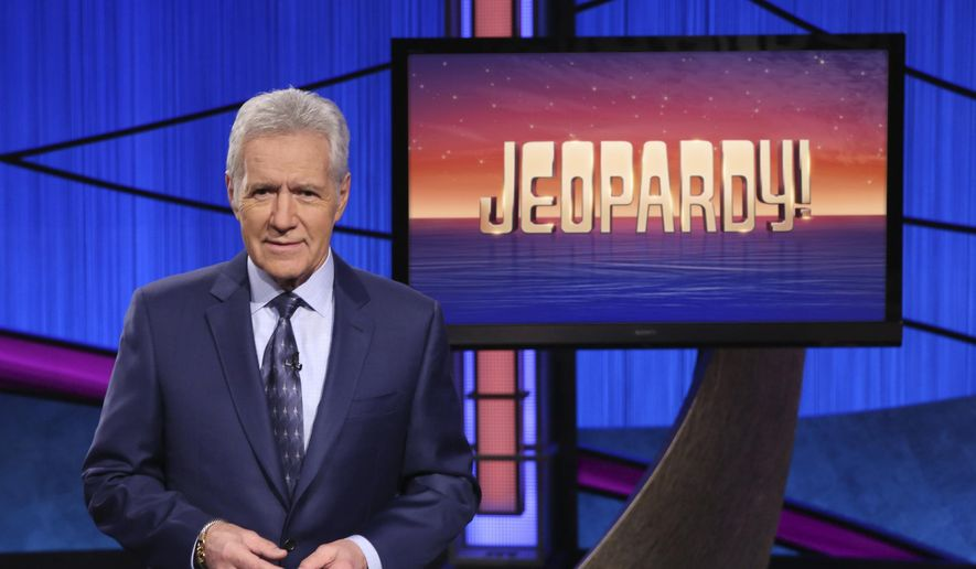 This image released by Jeopardy! shows Alex Trebek, host of the game show ';Jeopardy!' Filling the void left by Trebek after 37 years involves sophisticated research and a parade of guest hosts doing their best to impress viewers and the studio that will make the call.  (Jeopardy! via AP)