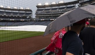 Fans gather to leave a postponed baseball game between the Washington Nationals and the San Francisco Giants at Nationals Park, Thursday, June 10, 2021, in Washington. The game was postponed until Saturday, June 12th. (AP Photo/Alex Brandon) ** FILE **