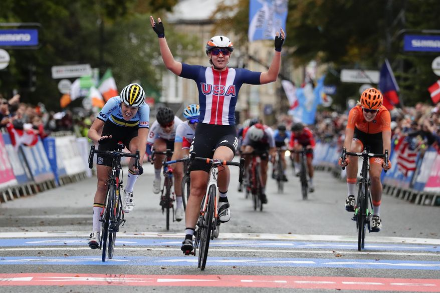 This Sept. 27, 2019, file photo shows United States' Megan Jastrab celebrating winning the women junior event at the road cycling World Championships in Harrogate, England. The cycling team that the U.S. is taking to the Tokyo Olympics is a little bit different than the one it would have taken a year ago, when the COVID-19 pandemic forced organizers to postpone the Summer Games by an entire year. Among those on the team announced Thursday, June 10, 2021, are mountain biker Haley Batten, who's been on the podium each of the first two World Cup races of the season; Jastrab, the 19-year-old track cycling prodigy who will be part of the gold medal-favorite women's pursuit team and also contest the Madison; and 23-year-old time trial star Brandon McNulty. (AP Photo/Manu Fernandez, File) **FILE**