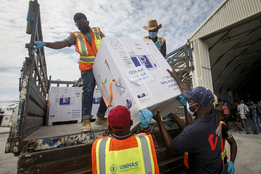 In this March 15, 2021, file photo, boxes of COVID-19 vaccine provided through the COVAX global initiative arrive at the airport in Mogadishu, Somalia. The Biden administration plans to provide 500 million shots purchased from Pfizer to 92 lower-income countries and the African Union over the next year through the U.N.-backed COVAX program. (AP Photo/Farah Abdi Warsameh, File)