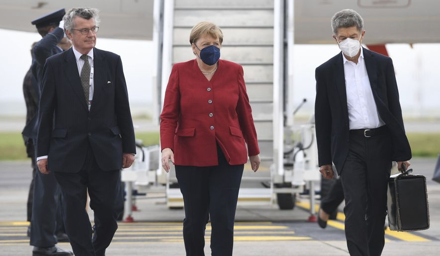 Chancellor of Germany Angela Merkel arrives at Cornwall Airport in Newquay, England, Friday, June 11, 2021, ahead of the G-7 summit. Leaders of the G-7 begin their first of three days of meetings on Friday in Carbis Bay, in which they will discuss COVID-19, climate, foreign policy and the economy. (Stefan Rousseau/Pool via AP)