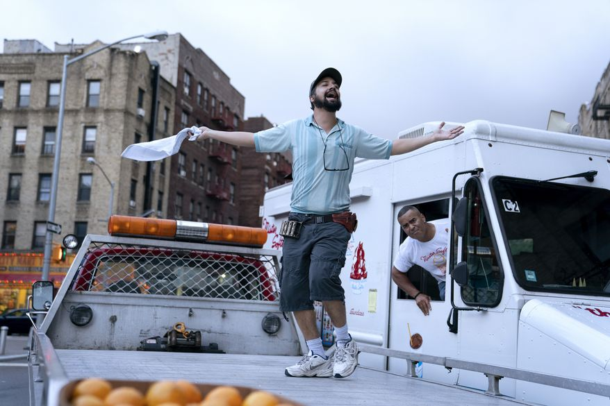 """This image released by Warner Bros. Entertainment shows Lin-Manuel Miranda, left, and Chris Jackson in a scene from """"In the Heights."""" (Macall Polay/Warner Bros. Entertainment via AP)"""
