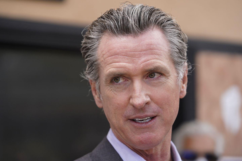 Gavin Newsom signs executive order to roll back California coronavirus restrictions