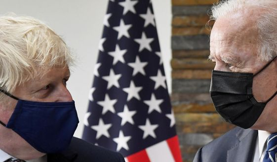U.S. President Joe Biden, right, talks with Britain's Prime Minister Boris Johnson, during their meeting ahead of the G-7 summit in Cornwall, Britain, Thursday, June 10, 2021. (Toby Melville/Pool Photo via AP)