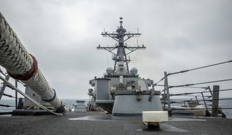 In this photo released by the U.S. Navy, the U.S. Arleigh Burke-class guided-missile destroyer USS Curtis Wilbur (DDG 54) conducts routine operations in the Taiwan Strait, May 18, 2021. China on Thursday, May 20, 2021, issued its second protest in as many days over United States naval activity in the region, drawing an unusually sharp response from the U.S. 7th Fleet, which accused Beijing of attempting to assert illegitimate maritime rights at the expense of its neighbors. (Mass Communication Specialist 3rd Class Zenaida Roth, U.S. Navy via AP) **FILE**