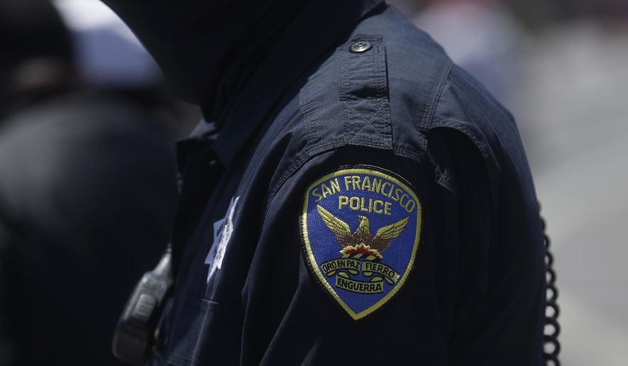 In this July 7, 2020, file photo a San Francisco Police Department patch is shown on an officer's uniform in San Francisco. Law enforcement agencies across the country experienced a wave of retirements and departures and are struggling to recruit the next generation of police officers in the year since George Floyd was killed by a cop. And amid the national reckoning on policing, communities are questioning who should become a police officer today. (AP Photo/Jeff Chiu, File)