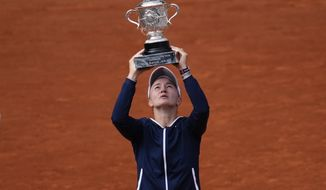 Czech Republic's Barbora Krejcikova lifts the cup after defeating Russia's Anastasia Pavlyuchenkova during their final match of the French Open tennis tournament at the Roland Garros stadium Saturday, June 12, 2021 in Paris. The unseeded Czech player defeated Anastasia Pavlyuchenkova 6-1, 2-6, 6-4 in the final. (AP Photo/Christophe Ena)