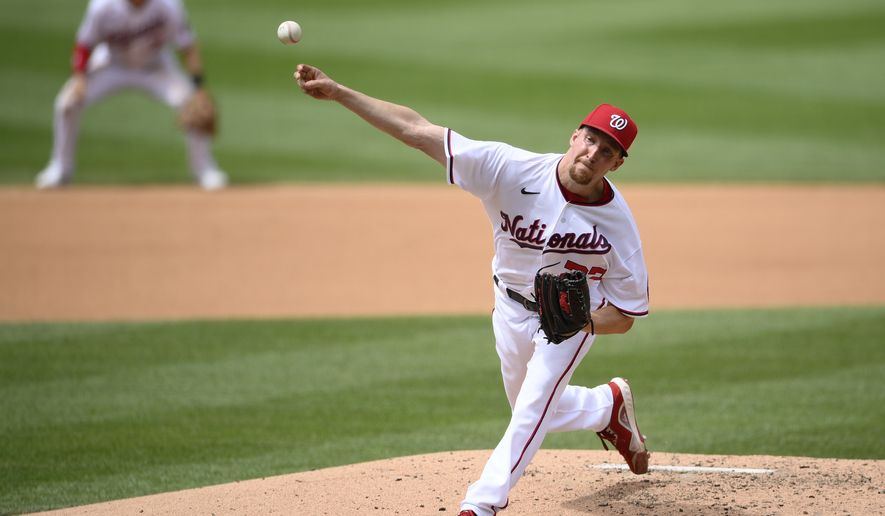 Washington Nationals starting pitcher Erick Fedde delivers a pitch during the fourth inning of the first baseball game of a doubleheader against the San Francisco Giants, Saturday, June 12, 2021, in Washington. This game is a makeup of a postponed game from Thursday. (AP Photo/Nick Wass)