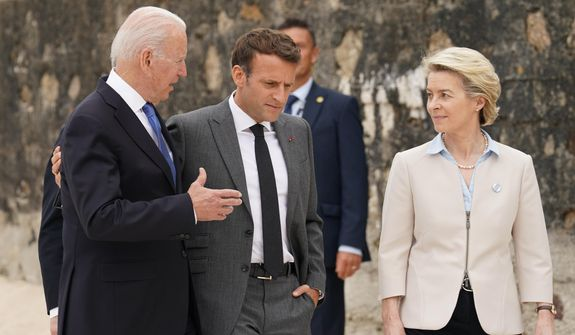 President Joe Biden speaks with French President Emmanuel Macron and European Commission President Ursula von der Leyen after posing for the G-7 family photo with guests at the G-7 summit, Friday, June 11, 2021, in Carbis Bay, England. (Kevin Lamarque/Pool via AP)