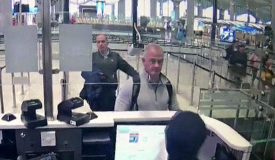 This Dec. 30, 2019, image from security camera video shows Michael L. Taylor, center, and George-Antoine Zayek at passport control at Istanbul Airport in Turkey. Americans Michael Taylor and his son Peter Taylor go on trial in Tokyo on Monday, June 14, 2021, on suspicion they helped Nissan former Chairman Carlos Ghosn skip bail in Japan and escape to Lebanon in December 2019. (DHA via AP, File)