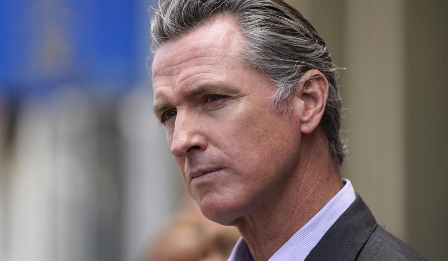In this June 3, 2021 file photo, California Gov. Gavin Newsom listens to questions during a news conference outside a restaurant in San Francisco While governors across the country are ending all or most of their coronavirus restrictions, many of them are keeping their pandemic emergency orders in place. Those orders allow them to restrict public gatherings and businesses, mandate masks, sidestep normal purchasing rules, tap into federal money and deploy National Guard troops to administer vaccines.  (AP Photo/Eric Risberg, File)