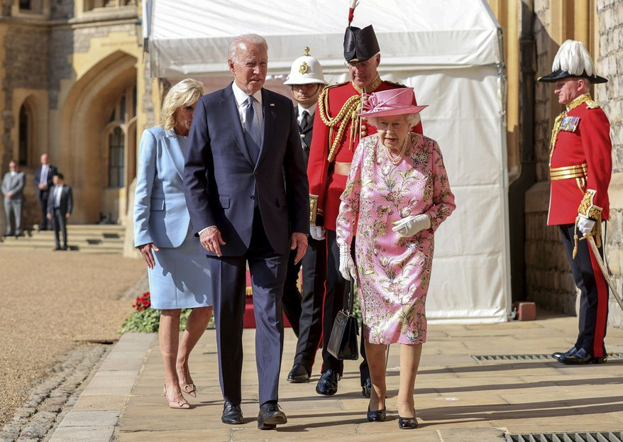 Britain's Queen Elizabeth II with President Joe Biden and First Lady Jill Biden during a visit to Windsor Castle, in Windsor, England, Sunday June 13, 2021. The queen hosted President Joe Biden and First Lady Jill Biden at Windsor Castle, her royal residence near London. Biden flew to London after wrapping up his participation in a three-day summit of leaders of the world's wealthy democracies in Cornwall, in southwestern England. (Arthur Edwards/Pool via AP)