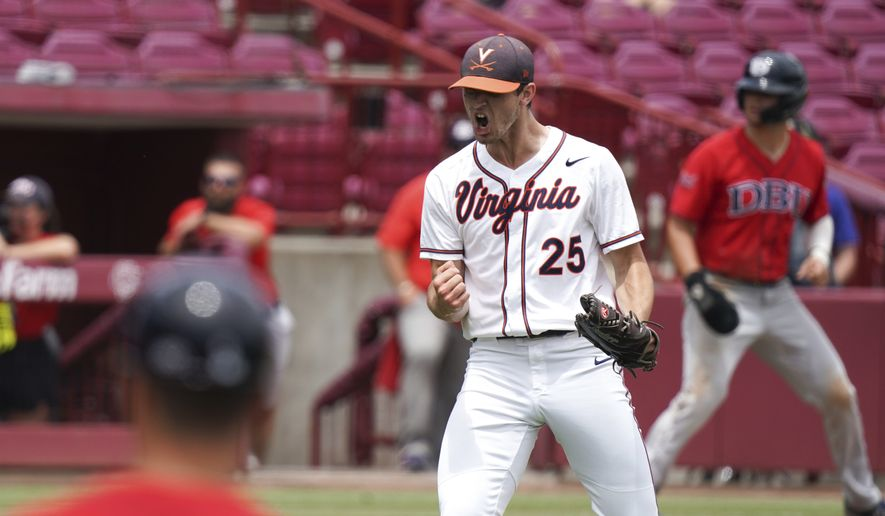 Virginia pitcher Griff McGarry reacts after an inning-ending strikeout during an NCAA college baseball tournament super regional game against Dallas Baptist, Sunday, June 13, 2021, in Columbia, S.C. (AP Photo/Sean Rayford)