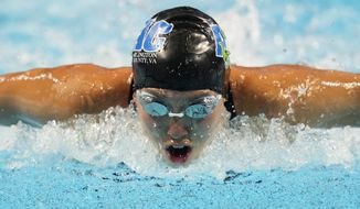 Torri Huske participates in the Women's 100 Butterfly during wave 2 of the U.S. Olympic Swim Trials on Sunday, June 13, 2021, in Omaha, Neb. (AP Photo/Charlie Neibergall)