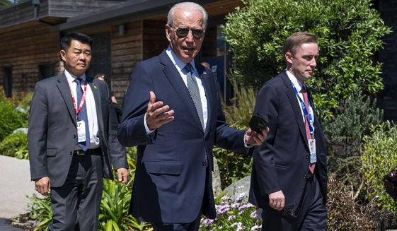 President Joe Biden walks with national security adviser Jake Sullivan, right, and members of the Secret Service as he arrives for the final session of the G-7 summit in Carbis Bay, England, Sunday, June 13, 2021. (Doug Mills/The New York Times via AP, Pool)