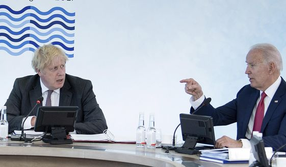 Britain's Prime Minister Boris Johnson, left, listens to U.S. President Joe Biden during a working session at the G7 summit in Carbis Bay, Cornwall, England, Saturday, June 12, 2021. (Brendan Smialowski/Pool Photo via AP)