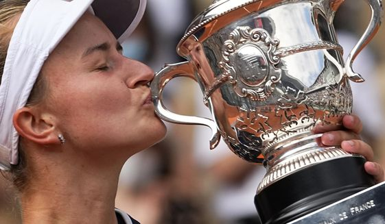 Czech Republic's Barbora Krejcikova kisses the cup after defeating Russia's Anastasia Pavlyuchenkova during their final match of the French Open tennis tournament at the Roland Garros stadium Saturday, June 12, 2021 in Paris. (AP Photo/Michel Euler) **FILE***