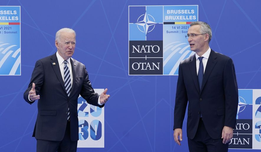 President Joe Biden is greeted by NATO Secretary-General Jens Stoltenberg at the NATO summit at NATO headquarters in Brussels, Monday, June 14, 2021. (AP Photo/Patrick Semansky, Pool)