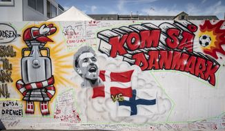 Messages to soccer player Christian Eriksen written on the wall at Football Village in Copenhagen, Monday June 14, 2021. The Denmark midfielder fell face-forward onto the field with cardiac arrest during the teams opening game against Finland on Saturday. Eriksen was resuscitated with a defibrillator and in a stable condition in a Copenhagen hospital on Monday. (Mads Claus Rasmussen/Ritzau Scanpix via AP)