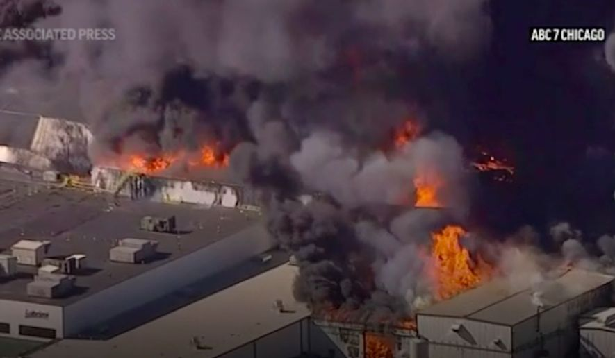 An explosion at a chemical plant near the northern Illinois community of Rockton sparked a massive fire that sent flames and huge plumes of thick black smoke high into the air Monday morning, June 14, 2021. (Associated Press/video screengrab)