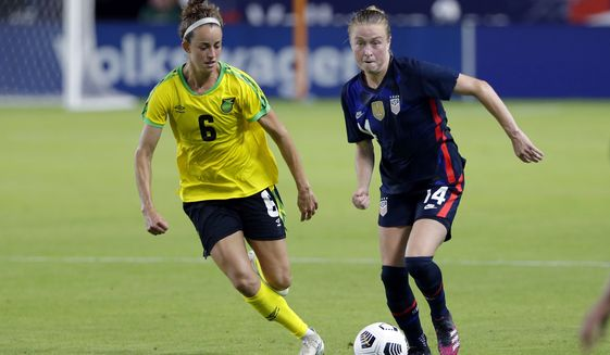 USA defender Emily Sonnett (14) moves the ball past Jamaica midfielder Havana Solaun (6) during the second half of their 2021 WNT Summer Series match Sunday, June 13, 2021, in Houston. (AP Photo/Michael Wyke) ** FILE **