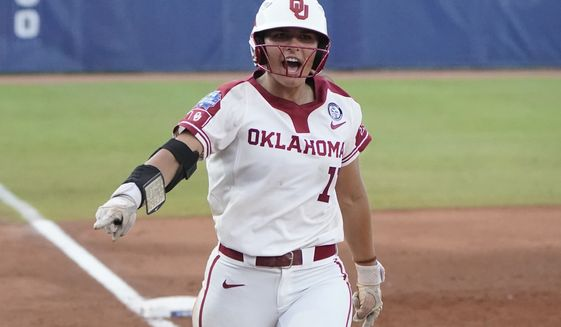 Oklahoma's Nicole Mendes (11) runs home with a home run in the first game of the NCAA Women's College World Series softball championship series against Florida State, Tuesday, June 8, 2021, in Oklahoma City. (AP Photo/Sue Ogrocki)