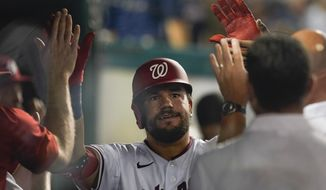 Washington Nationals' Kyle Schwarber celebrates his go-ahead home run in the seventh inning of a baseball game against the Pittsburgh Pirates, Monday, June 14, 2021, in Washington. (AP Photo/Carolyn Kaster)