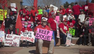 In this March 1, 2021, photo, protesters and counter-protesters gather at the Dixie State University campus to express opinions on the potential name change of the university in St. George, Utah. A committee created to consider a name change for a university in Utah voted Monday, June 7, 2021, to choose a name that does not include Dixie — a regional term many consider offensive because of its association with the Deep South and slavery. (Chris Caldwell /The Spectrum via AP) ** FILE **