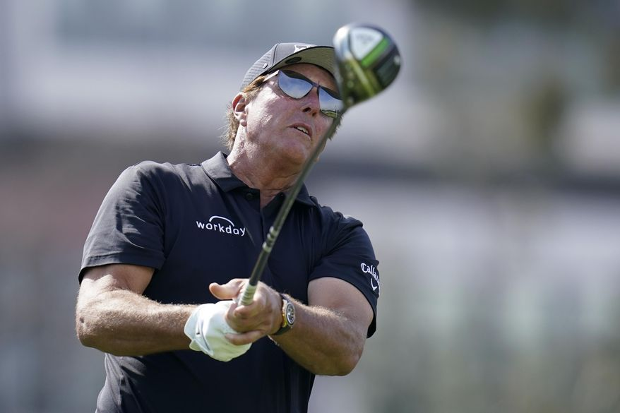 Phil Mickelson watches his tee shot on the 12th hole during a practice round of the U.S. Open Golf Championship Monday, June 14, 2021, at Torrey Pines Golf Course in San Diego. (AP Photo/Gregory Bull) **FILE**