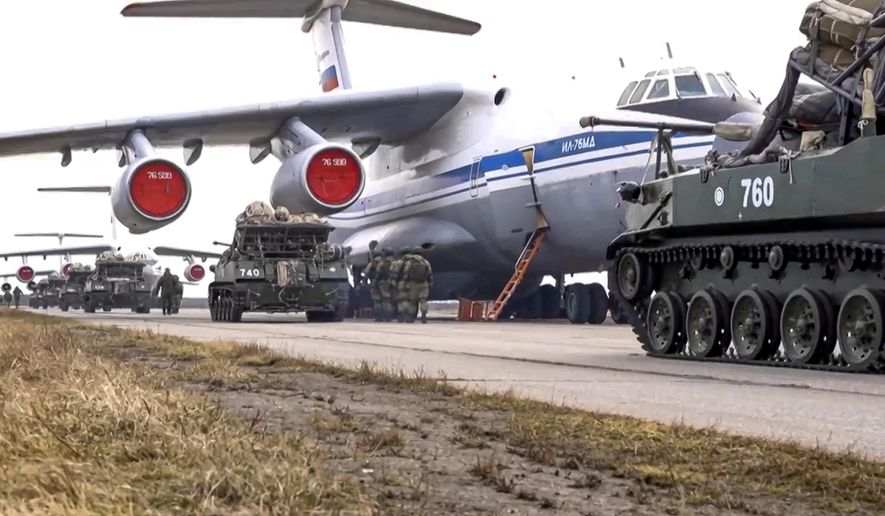In this April 22, 2021, file photo provided by Russian Defense Ministry Press Service, Russian military vehicles prepare to be loaded into a plane for airborne drills during maneuvers in Crimea. Earlier this year, Russia bolstered its forces near Ukraine and warned Kyiv that it could intervene militarily if Ukrainian authorities try to retake the rebel-controlled east. Moscow also has bristled at NATO's joint drills with Ukraine, saying they reflect the alliance's aggressive intentions. (Russian Defense Ministry Press Service via AP, File)