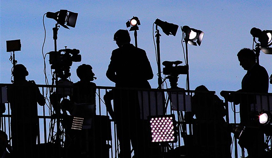 Australian media experts have joined U.S. critics in denouncing the political bias and unfair reporting which persists in the U.S. press.  (AP PHOTO)