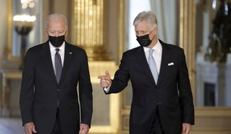 Belgium's King Philippe, right, gestures as he walks with U.S. President Joe Biden prior to a meeting at the Royal Palace in Brussels, Tuesday, June 15, 2021. (AP Photo/Olivier Matthys)