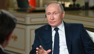 In this photo, Russian President Vladimir Putin speaks to NBC News journalist Keir Simmons, back to a camera, in an interview aired on Monday, June 14, 2021, two days before the Russian leader is to meet U.S. President Joe Biden in Geneva. (Maxim Blinov, Sputnik, Kremlin Pool Photo via AP, File)