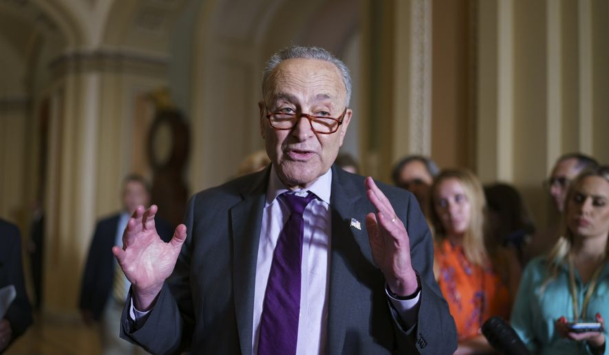 Senate Majority Leader Chuck Schumer, D-N.Y., and the Democratic leadership speak to reporters about progress on an infrastructure bill and voting rights legislation, at the Capitol in Washington, Tuesday, June 15, 2021. (AP Photo/J. Scott Applewhite) ** FiLE **