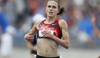 In this Sunday, July 28, 2019, file photo, Shelby Houlihan crosses the finish line as she wins the women's 5,000-meter run at the U.S. Championships athletics meet, in Des Moines, Iowa. (AP Photo/Charlie Neibergall, File)
